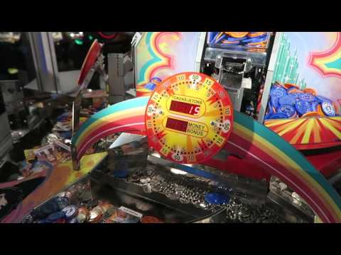 Winning all 7 cards & more!! wizard of oz coin pusher best arcade game dave & buster's nyc