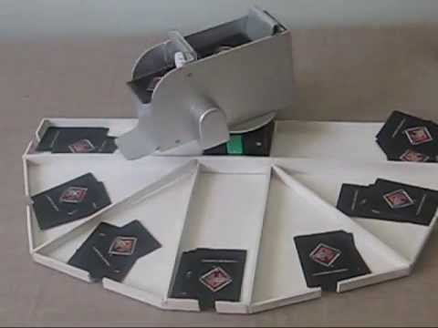 Automatic playing cards dealing machine